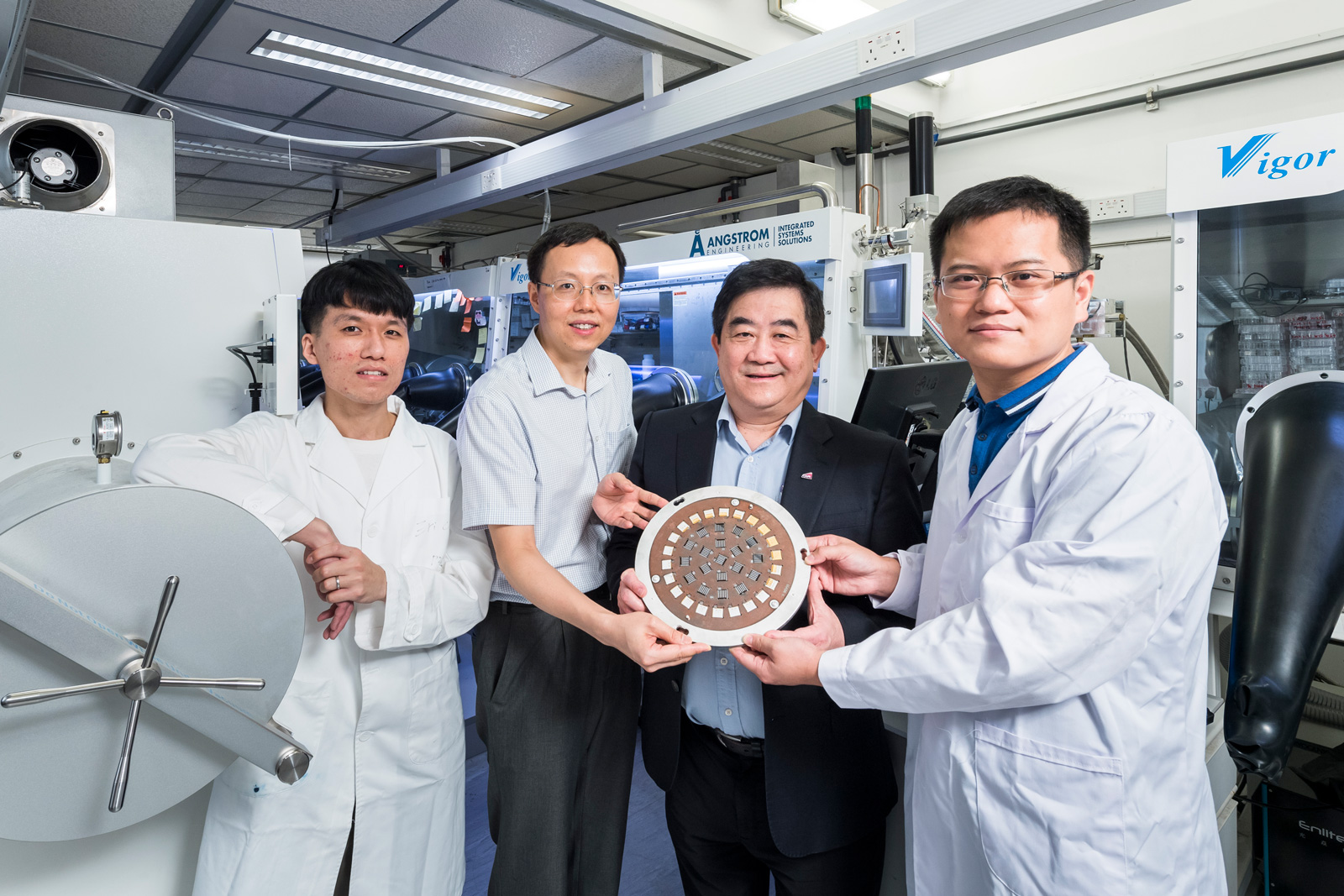 Key members of the research team: (from left) Wu Shengfan, Professor Xu Zhengtao, Professor Alex Jen Kwan-yue, and Dr Zhu Zonglong.
