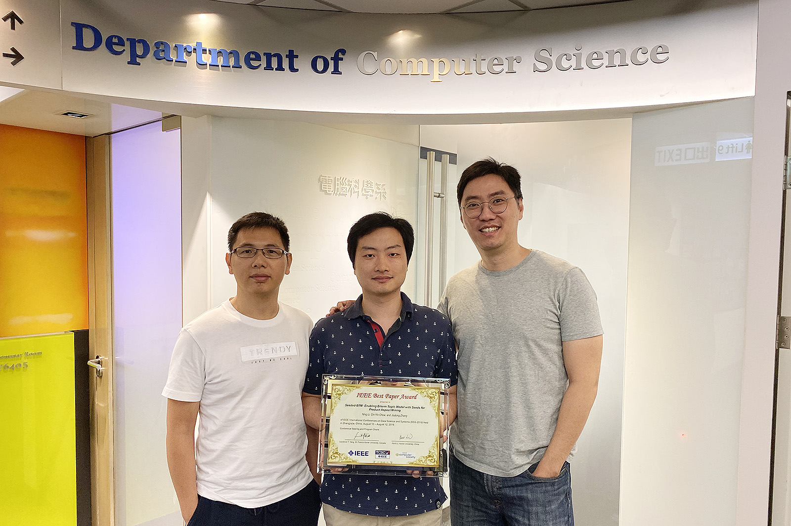 (From left) Dr Zhang Jiadong, Mr Li Ning and Dr Ted Chow with the Best Paper Award from IEEE's International Conference on Data Science and systems.