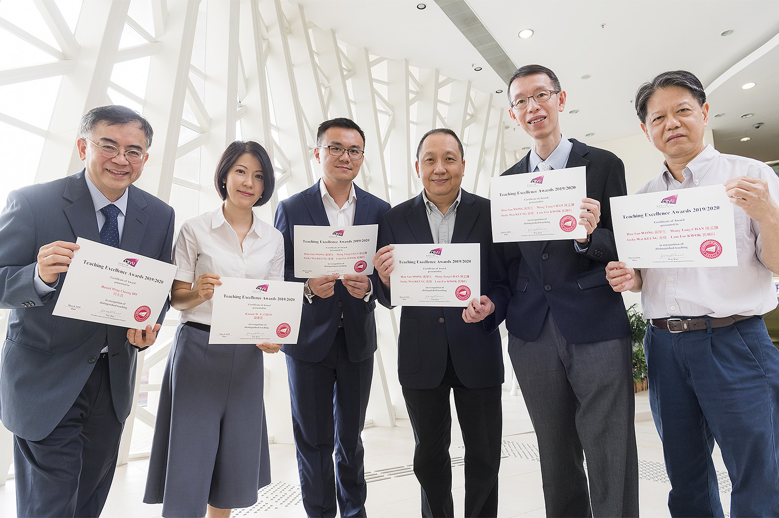 TEA winners at CityU (from left): Professor Daniel Ho Wing-cheong, Dr Kannie Chan Wai-yan, and the IT Professional Placement Team comprising Dr Jacky Keung Wai, Dr Chan Mang-tang, Dr Raymond Wong Hau-san and Dr Kwok Lam-for.