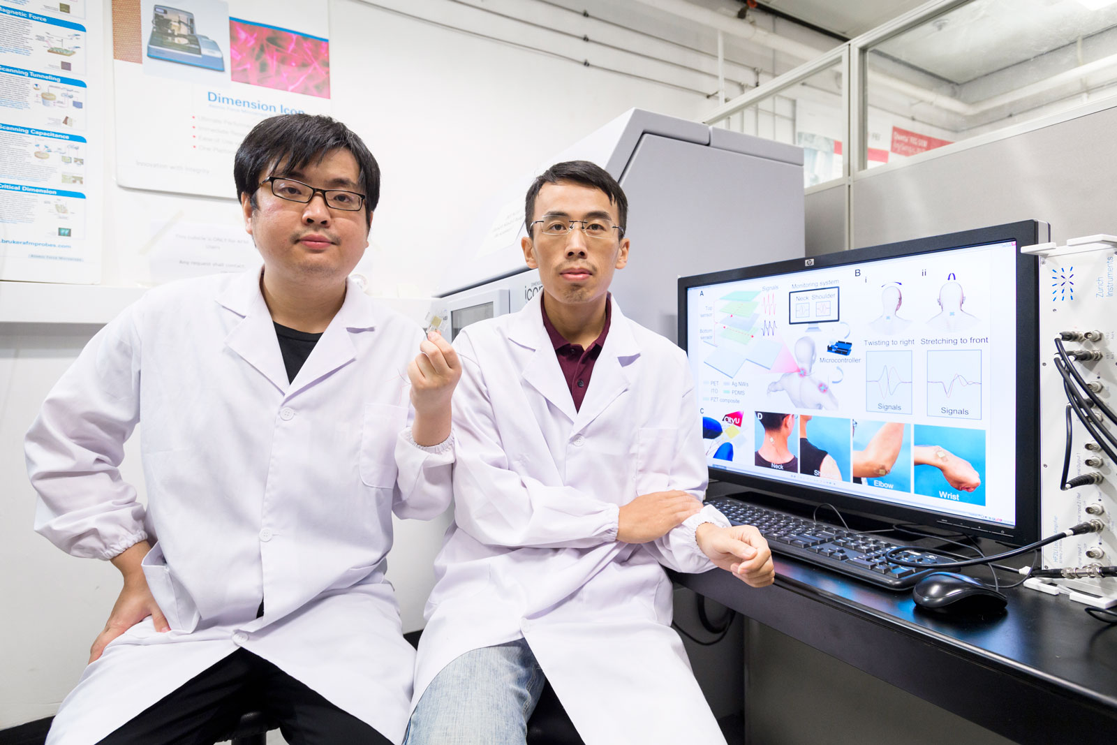 (From right) Dr Yang Zhengbao and Hong Ying, members of the research team.