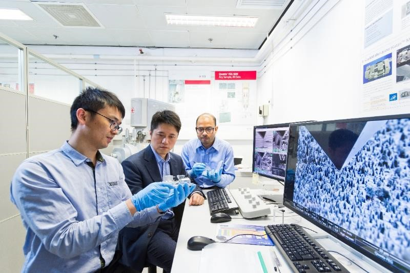 "When the surprising result of elasticity in nanoscale diamond was first discovered, Dr Lu (centre) and his team were ""extremely excited"". The instrument that Zhang Hongti (left) holding is nanoindenter."