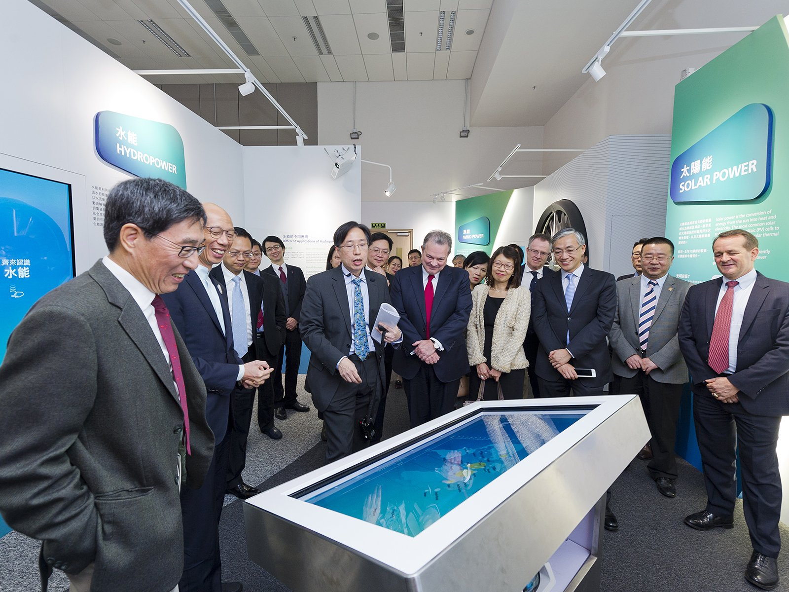 The guests visit the Low Carbon Energy Education Centre and are impressed by the interactive exhibits.