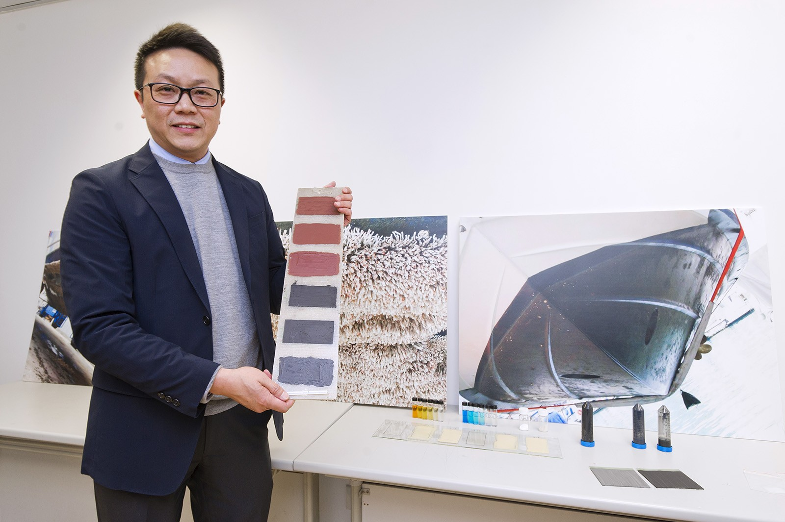 Professor Michael Leung shows the eco-friendly antifouling paint in his research.