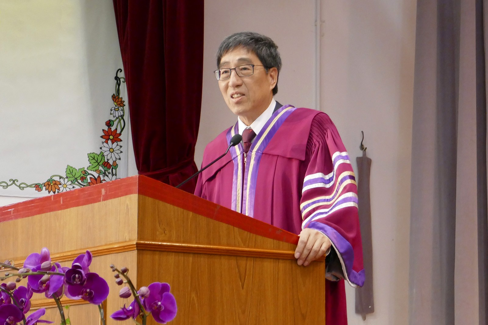 Professor Kuo delivers an address during speech day at a local secondary school.
