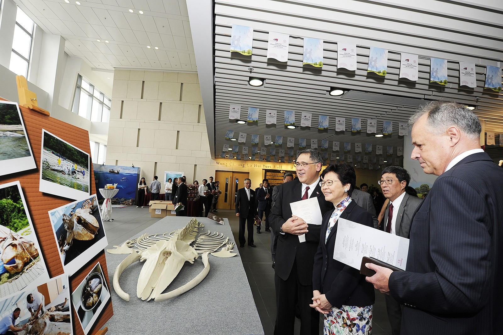Mrs Carrie Lam (2nd on left) views an exhibition during the naming ceremony for the Jockey Club College of Veterinary Medicine and Life Sciences.