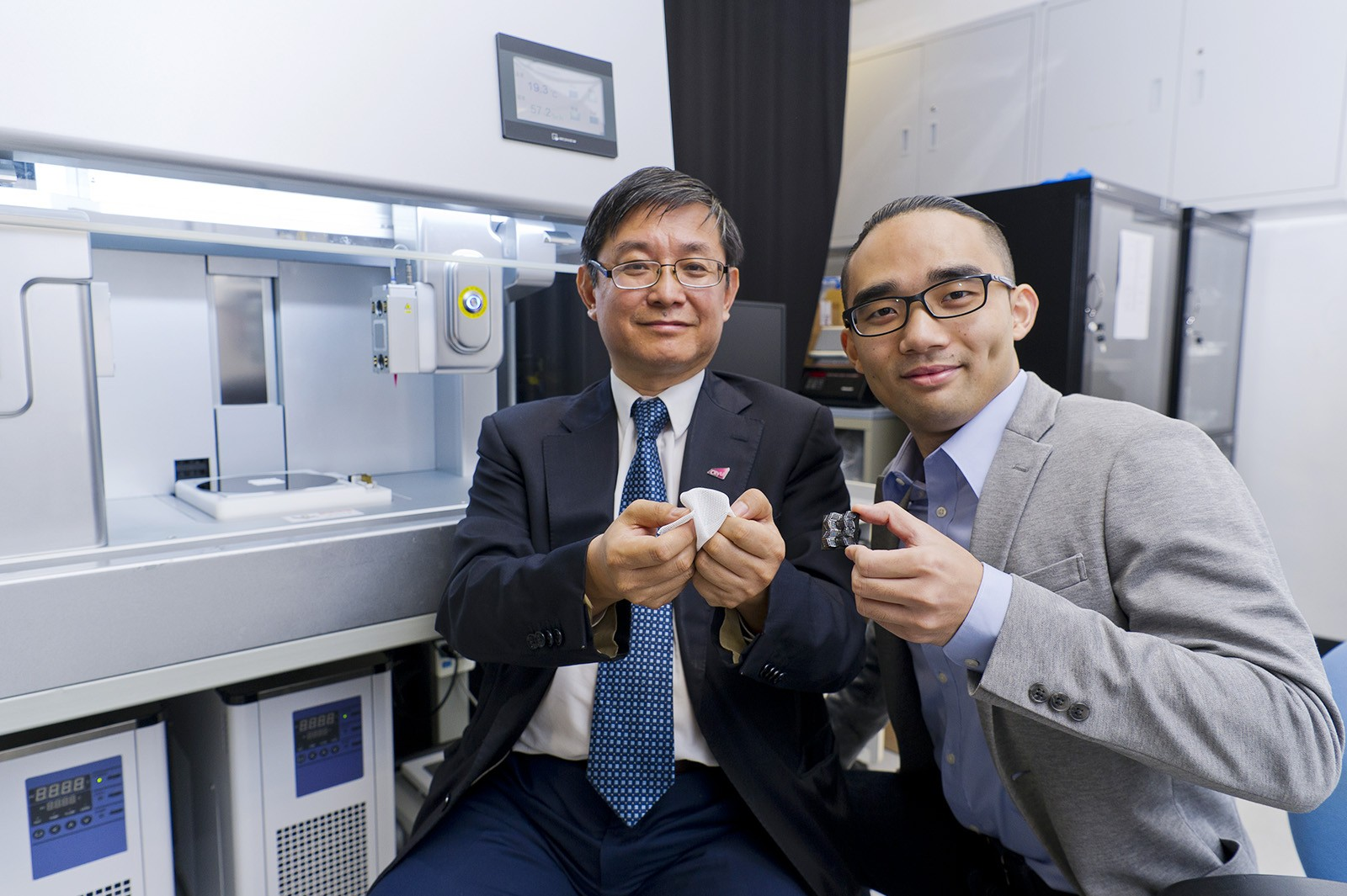 Professor Lu Jian (left), Dr Liu Guo and the research team have developed the world's first-ever 4D printing for ceramics.