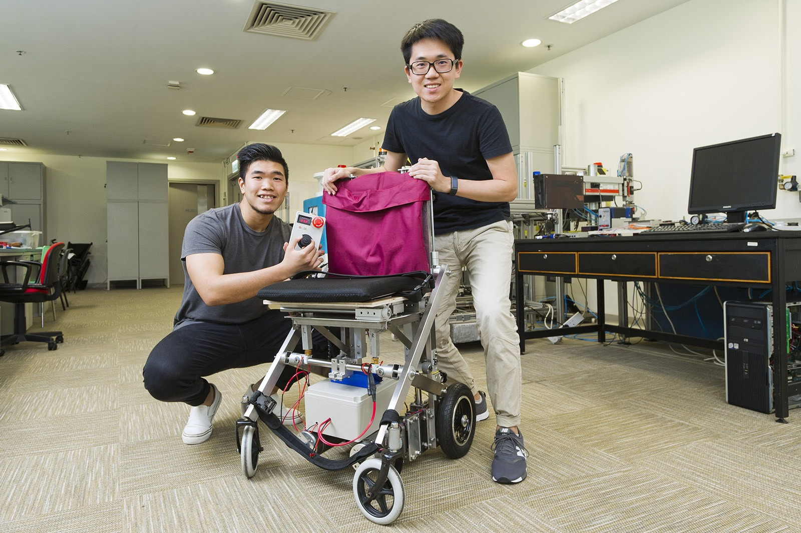 Transformable wheelchair developed by Chan Tsz-lung (left) and his teammate Lam Wah-shing.
