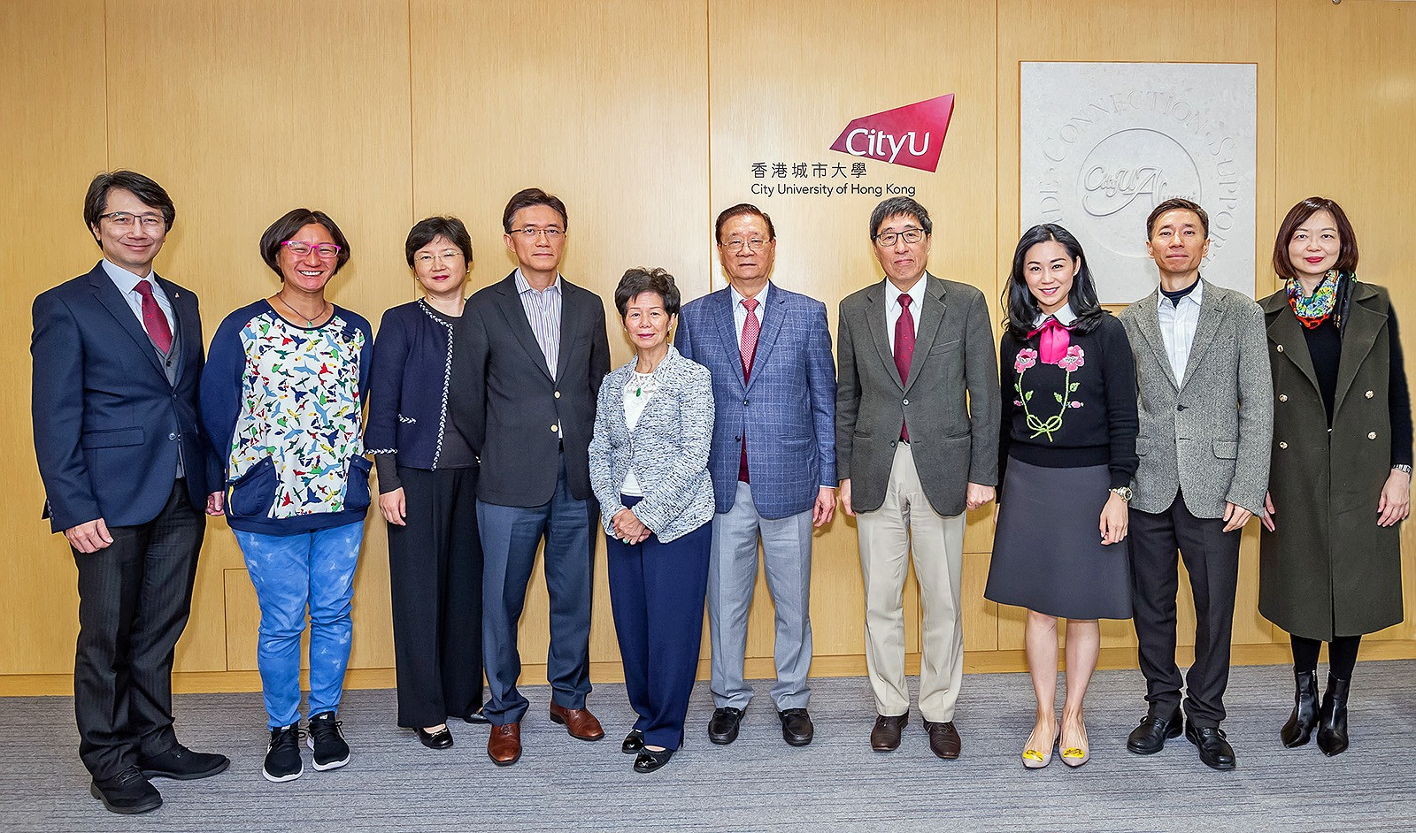 Mr and Mrs Chu, their family members and CityU senior management at the cheque presentation ceremony.