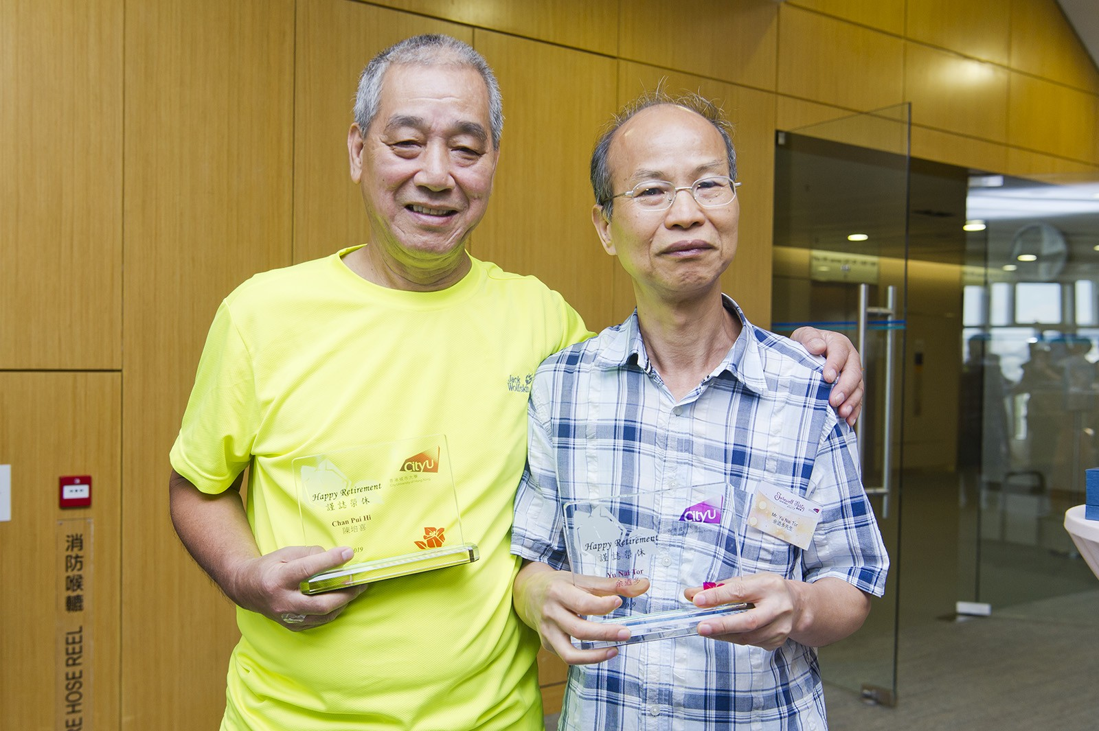 Mr Chan (left) and Mr Yu (right) have both witnessed how CityU has changed over the years.